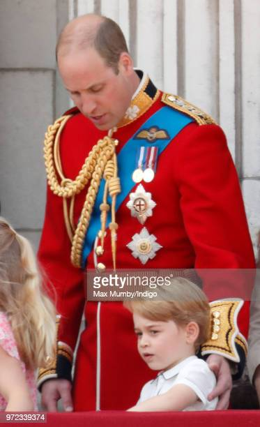 Prince William Duke of Cambridge and Prince George of Cambridge stand on the balcony of Buckingham Palace during Trooping The Colour 2018 on June 9...