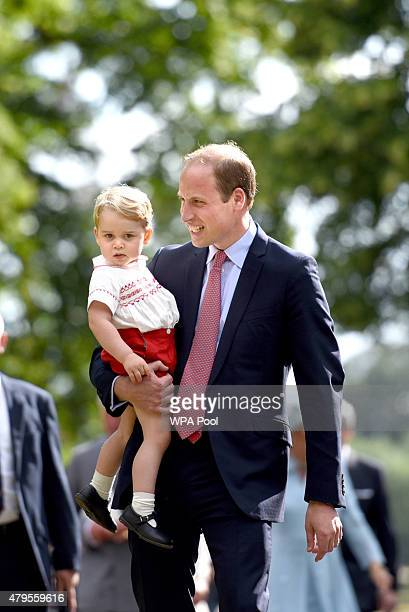 Prince William Duke of Cambridge and Prince George of Cambridge walk past crowds as they leave the Church of St Mary Magdalene on the Sandringham...
