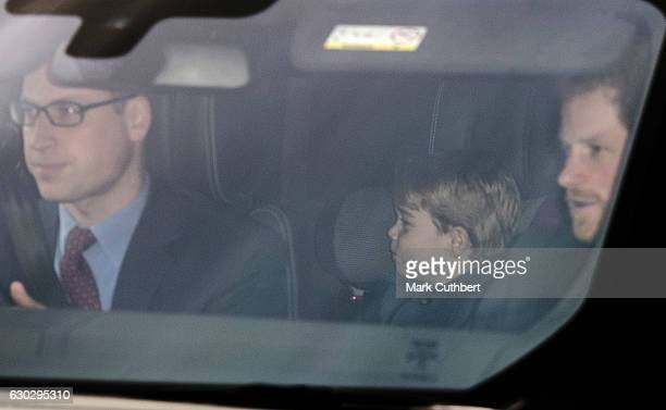 Prince William Duke of Cambridge and Prince George of Cambridge with Prince Harry attend the annual Buckingham Palace Christmas lunch hosted by The...