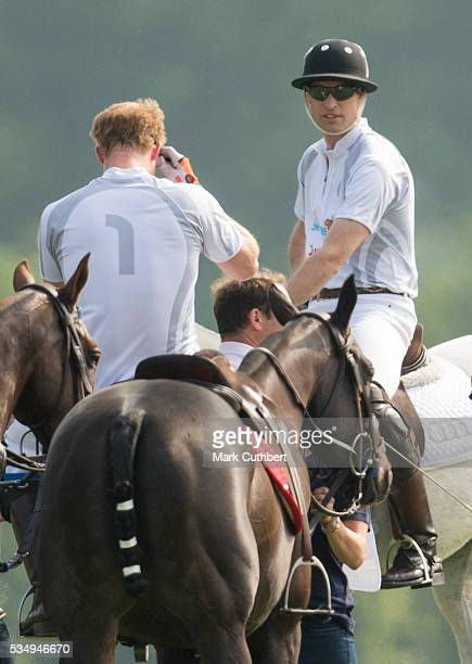 Prince William Duke of Cambridge and Prince Harry at The Audi Polo Challenge at Coworth Park on May 28 2016 near Ascot England