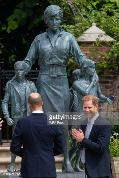 Prince William, Duke of Cambridge and Prince Harry, Duke of Sussex unveil a statue they commissioned of their mother Diana, Princess of Wales, in the...