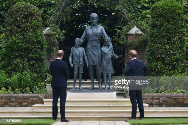 Prince William, Duke of Cambridge and Prince Harry, Duke of Sussex look at a statue they commissioned of their mother Diana, Princess of Wales, in...