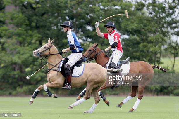 Prince William Duke of Cambridge and Prince Harry Duke of Sussex compete during the King Power Royal Charity Polo Day for the Vichai...
