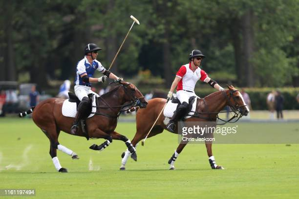 Prince William, Duke of Cambridge and Prince Harry, Duke of Sussex compete during the King Power Royal Charity Polo Day for the Vichai...