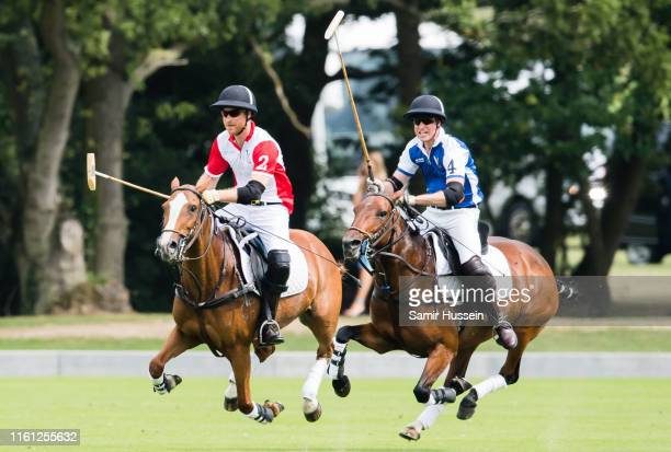 Prince William, Duke of Cambridge and Prince Harry, Duke of Sussex play during The King Power Royal Charity Polo Day at Billingbear Polo Club on July...