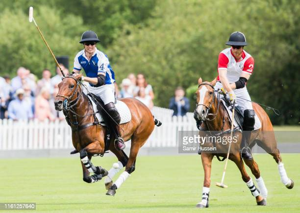 Prince William Duke of Cambridge and Prince Harry Duke of Sussex play during The King Power Royal Charity Polo Day at Billingbear Polo Club on July...