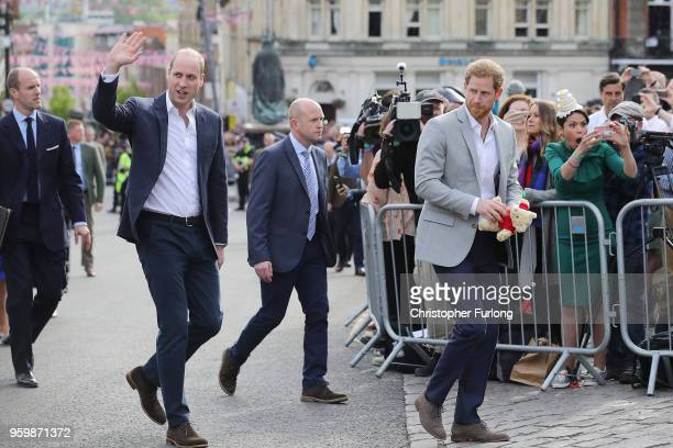 Prince William Duke of Cambridge and Prince Harry embark on a walkabout ahead of the royal wedding of Prince Harry and Meghan Markle on May 18 2018...