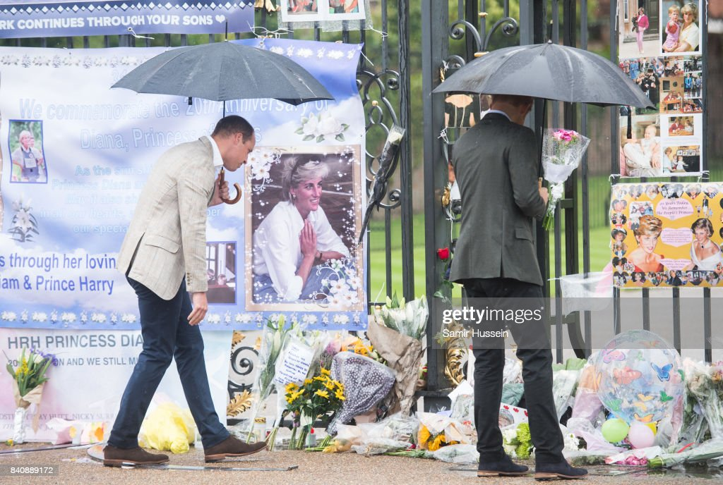 Prince William, Duke of Cambridge and Prince Harry look upon flowers, photos and other souvenirs left as a tribute to Princess Diana near The Sunken Garden at Kensington Palace on August 30, 2017 in London, England.
