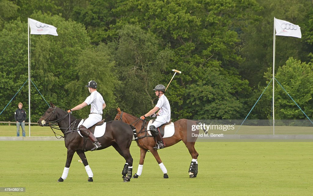 Prince William, Duke of Cambridge, and Prince Harry play during day two of the Audi Polo Challenge at Coworth Park on May 31, 2015 in London, England.