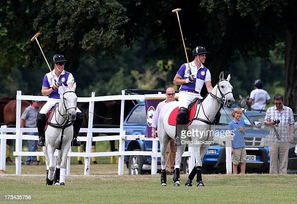 Prince William Duke of Cambridge and Prince Harry take part in The Jerudong Trophy at Cirencester Park Polo Club on July 14 2013 in Cirencester...