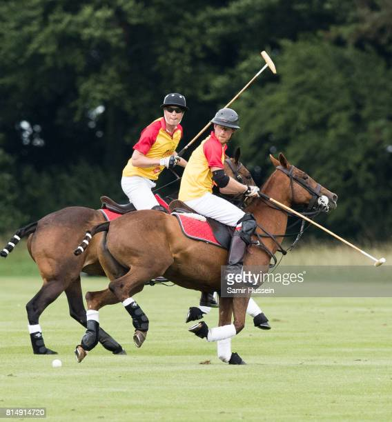 Prince William Duke of Cambridge and Prince Harry take part in The Jerudong Park Trophy at Cirencester Park Polo Club on July 15 2017 in Cirencester...