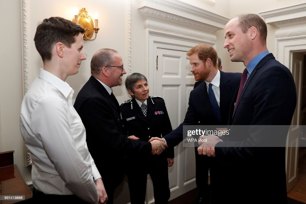 Prince William, Duke of Cambridge and Prince Harry talk Metropolitan Police Commissioner Cressida Dick (C) police officer of the year PC Philip Stone (2L), and police staff of the year, Claire Summers as they host the winners of The Met Excellence Awards at Kensington Palace on March 13, 2018 in London, England.