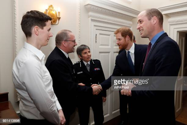 Prince William Duke of Cambridge and Prince Harry talk Metropolitan Police Commissioner Cressida Dick police officer of the year PC Philip Stone and...