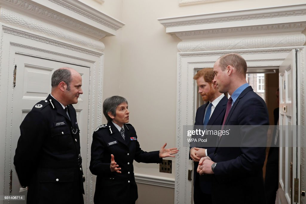 Prince William, Duke of Cambridge and Prince Harry talk with Metropolitan Police Commissioner Cressida Dick (C) and Police commander Stuart Cundy as they host the winners of The Met Excellence Awards at Kensington Palace on March 13, 2018 in London, England.