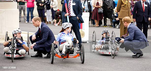 Prince William Duke of Cambridge and Prince Harry talk with Staff Sergeant Steve Arnold Corporal Claire Edwards and US Veteran Corporal Charlie Lemon...