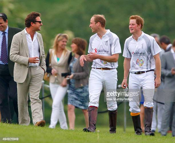 Prince William, Duke of Cambridge and Prince Harry talk with Thomas van Straubenzee after playing in the Audi Polo Challenge at Coworth Park Polo...