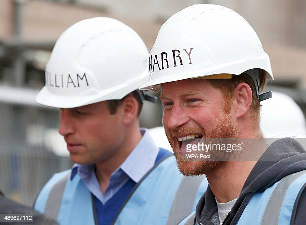 Prince William Duke of Cambridge and Prince Harry tour a building site as work continues to help renovate homes for exservice personnel as part of...