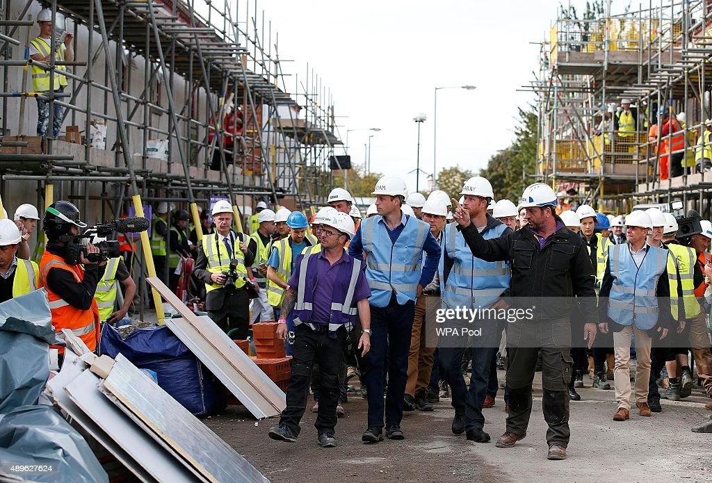 Prince William, Duke of Cambridge and Prince Harry tour a building site as work continues to help renovate homes for ex-service personnel as part of the BBC television DIY SOS series on September 23, 2015 in Manchester, England. Prince William and Prince Harry visited Manchester on Wednesday where they helped to renovate homes for ex-service personnel as part of the BBC television DIY SOS series.