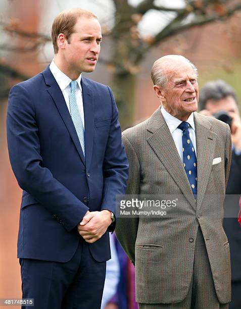 Prince William Duke of Cambridge and Prince Philip Duke of Edinburgh attend the Windsor Greys Statue unveiling on March 31 2014 in Windsor England...