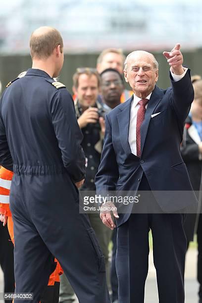 Prince William Duke of Cambridge and Prince Philip Duke of Edinburgh share a joke as they open the new East Anglian Air Ambulance Base at Cambridge...