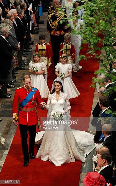 Prince William Duke of Cambridge and Princess Catherine Duchess of Cambridge leave the Westminster Abbey after their wedding ceremony on April 29...