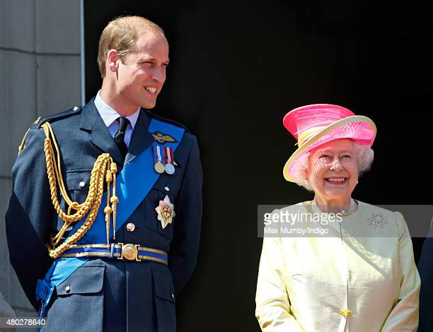 Prince William, Duke of Cambridge and Queen Elizabeth II watch a flypast of Spitfire & Hurricane aircraft from the balcony of Buckingham Palace to...