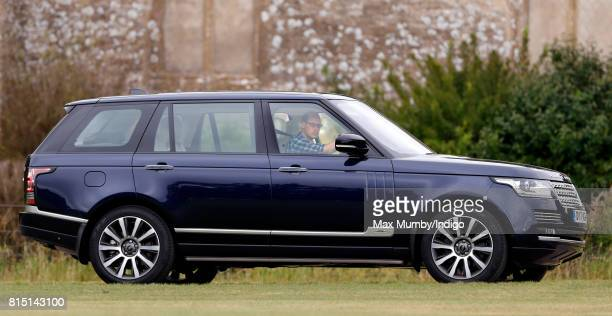 Prince William Duke of Cambridge arrives driving his Range Rover car to play in the Jerudong Park Trophy charity polo match at Cirencester Park Polo...