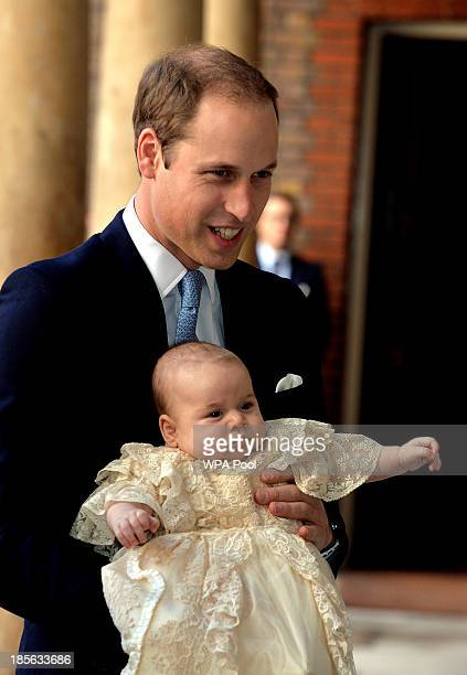 Prince William Duke of Cambridge arrives holding his son Prince George at Chapel Royal in St James's Palace ahead of the christening of the three...