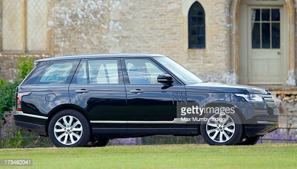 Prince William Duke of Cambridge arrives in his Range Rover car to play in the Jerudong Trophy polo match at Cirencester Park Polo Club on July 14...