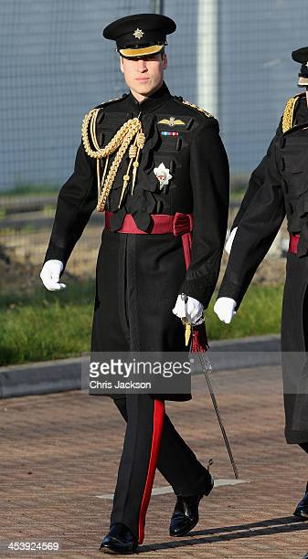 Prince William, Duke of Cambridge arrives to present service medals to First Battalion Irish Guards at Mons Barracks on December 6, 2013 in...