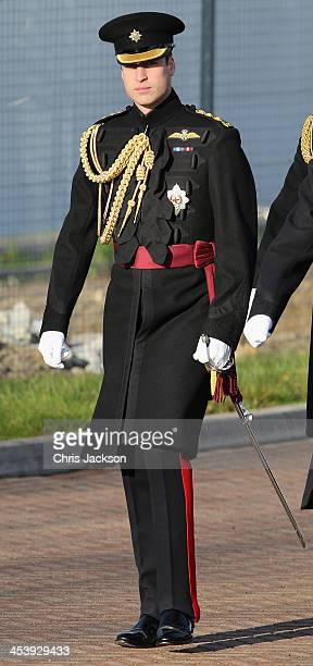 Prince William Duke of Cambridge arrives to present service medals to First Battalion Irish Guards at Mons Barracks on December 6 2013 in Aldershot...