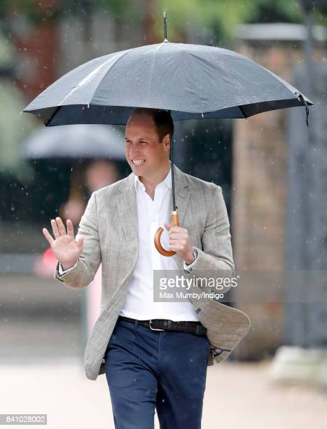 Prince William Duke of Cambridge arrives to view tributes to Diana Princess of Wales left at the gates of Kensington Palace after visiting the Sunken...