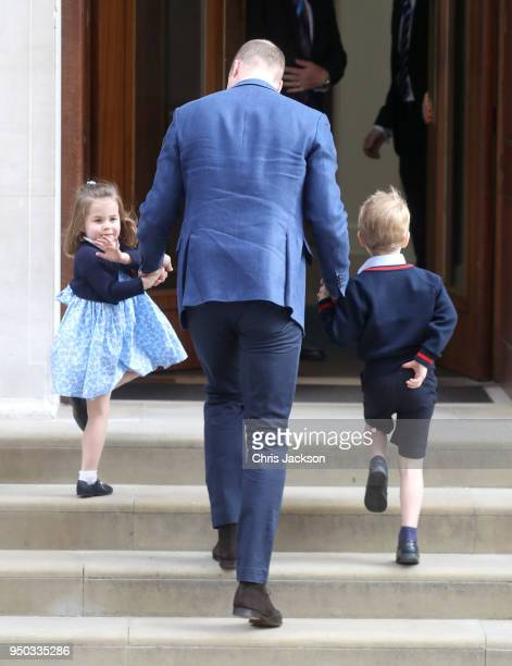 Prince William Duke of Cambridge arrives with Prince George and Princess Charlotte at the Lindo Wing after Catherine Duchess of Cambridge gave birth...