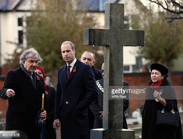 Prince William Duke of Cambridge as President of Fields in Trust walks with Colin Kerr Director External Relations of Commonwealth War Graves...