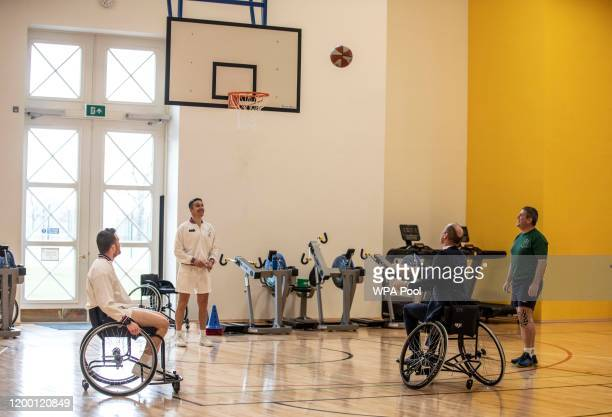 Prince William, Duke of Cambridge attempts to throw a basket ball into the hoop, during a visit to the defence medical rehabilitation centre Stanford...
