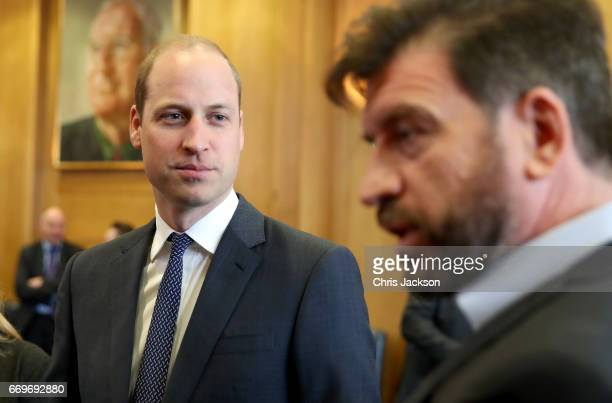 Prince William Duke of Cambridge attends a reception where he meets TV presenter Nick Knowles runners who feature in the documentary and the...