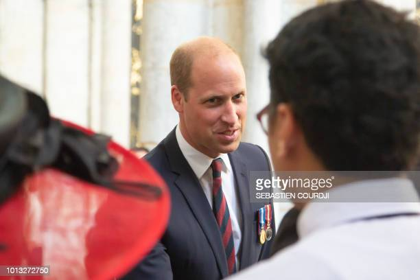 Prince William Duke of Cambridge attends a religious ceremony to mark the 100th anniversary of the World War I Battle of Amiens at the Cathedral in...
