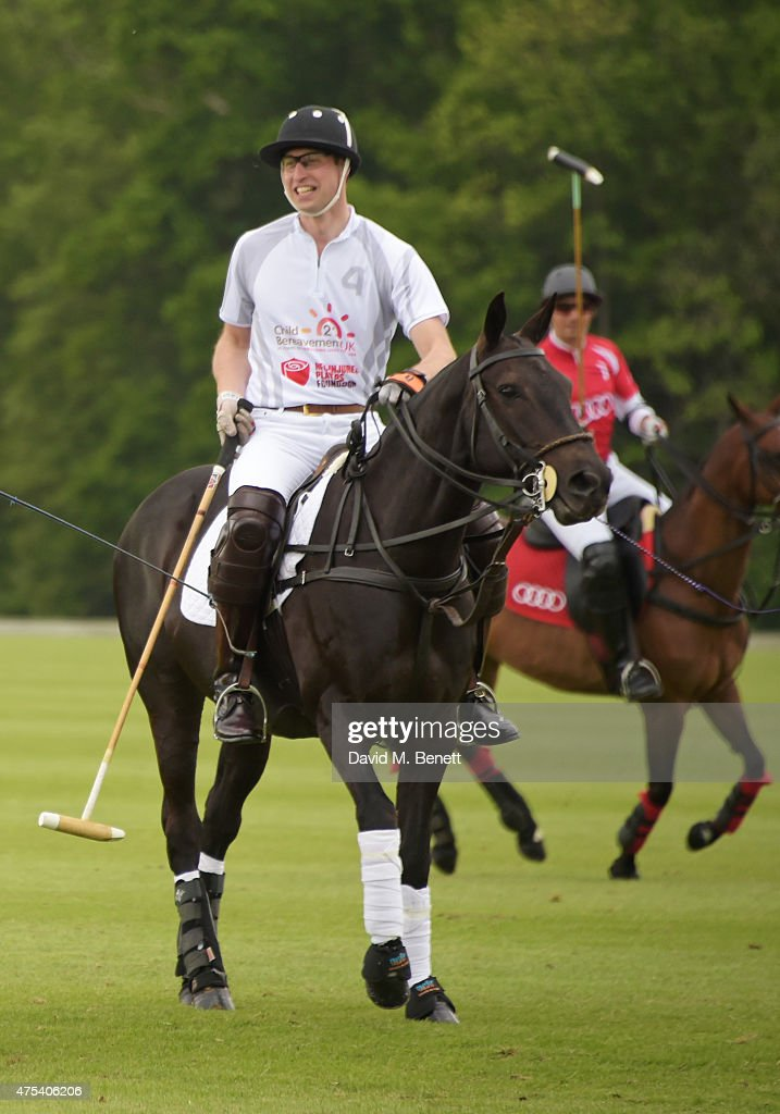 Prince William (L), Duke of Cambridge, attends day two of the Audi Polo Challenge at Coworth Park on May 31, 2015 in London, England.