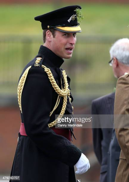 Prince William, Duke of Cambridge attends the St Patrick's Day parade at Mons Barracks on March 17, 2014 in Aldershot, England. Catherine, Duchess of...