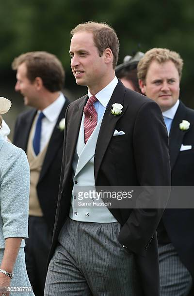 Prince William Duke of Cambridge attends the wedding of James Meade and Lady Laura Marsham at the parish church of St Nicholas in Gayton on September...