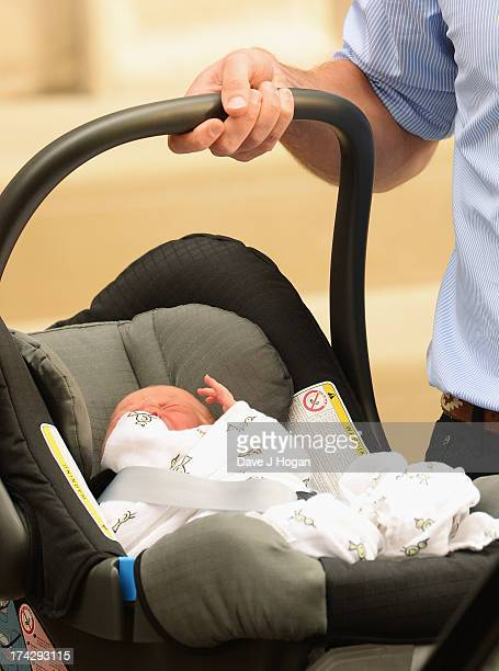 Prince William Duke of Cambridge carries his newborn son as he departs The Lindo Wing at St Mary's Hospital on July 23 2013 in London England The...
