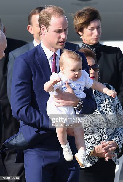 Prince William Duke of Cambridge carries Prince George of Cambridge as they arrive at Sydney Airport on a Australian Airforce 737 aircraft on April...