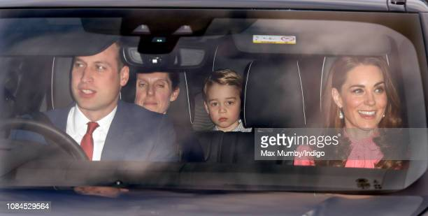 Prince William Duke of Cambridge Catherine Duchess of Cambridge and Prince George of Cambridge attend a Christmas lunch for members of the Royal...