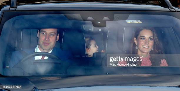 Prince William Duke of Cambridge Catherine Duchess of Cambridge and Princess Charlotte of Cambridge attend a Christmas lunch for members of the Royal...