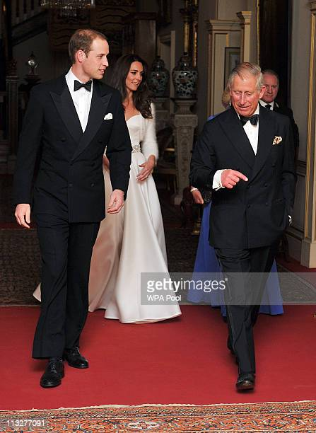 Prince William Duke of Cambridge Catherine Duchess of Cambridge and Prince Charles Prince of Wales leave Clarence House to travel to Buckingham...