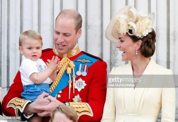 Prince William Duke of Cambridge Catherine Duchess of Cambridge and Prince Louis of Cambridge stand on the balcony of Buckingham Palace during...