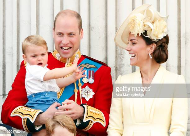 Prince William, Duke of Cambridge, Catherine, Duchess of Cambridge and Prince Louis of Cambridge watch a flypast from the balcony of Buckingham...