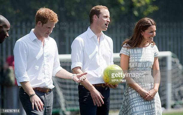 Prince William Duke of Cambridge Catherine Duchess of Cambridge and Prince Harry visit Bacon's College on July 26 2012 in London England Prince Harry...