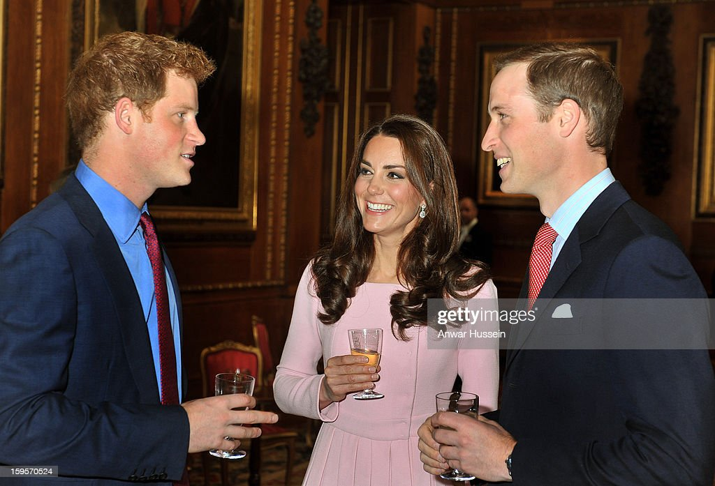 Prince William, Duke of Cambridge, Catherine, Duchess of Cambridge and Prince Harry chat during a pre luncheon reception for Sovereign Monarchs and guests in celebration of Queen Elizabeth's Diamond Jubilee at Windsor Castle on May 18, 2012 in Windsor, England.