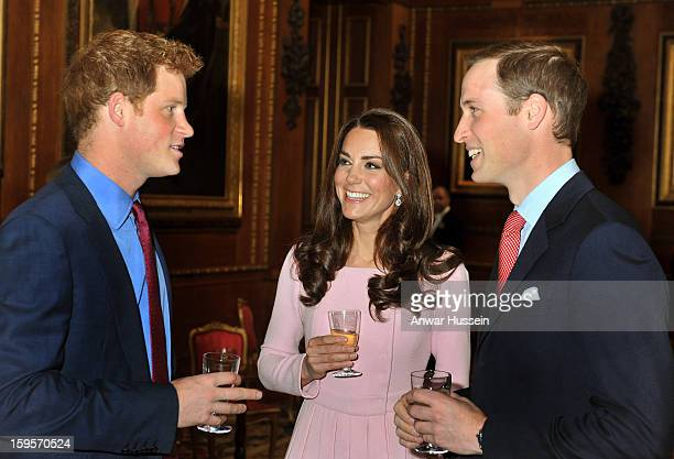 Prince William Duke of Cambridge Catherine Duchess of Cambridge and Prince Harry chat during a pre luncheon reception for Sovereign Monarchs and...